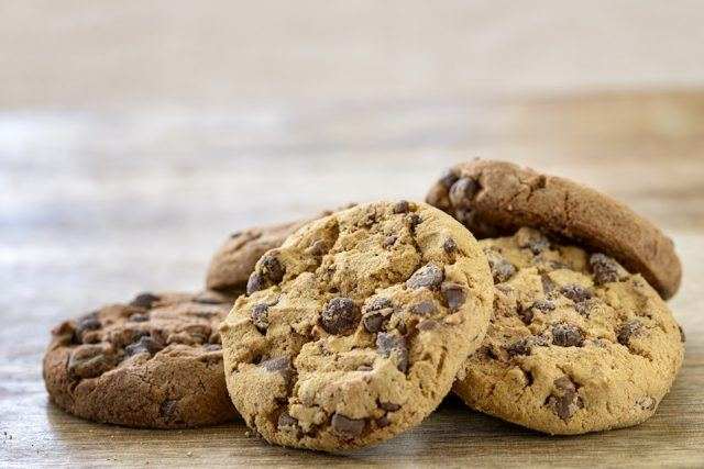 Chocolate chip cookies on a wooden table.