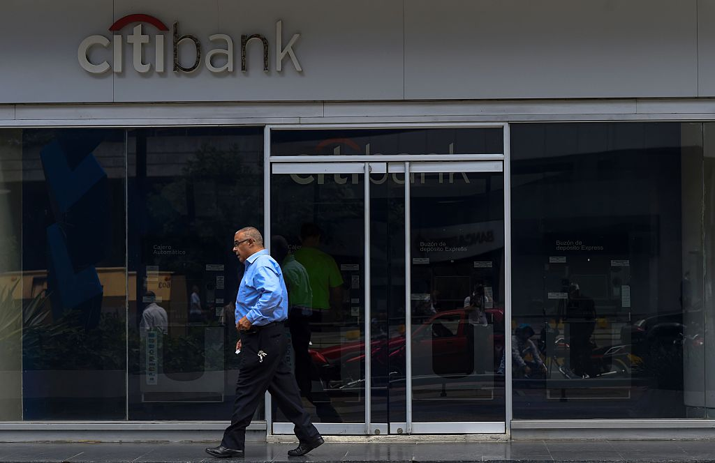 A man walks past a branch of US Citibank