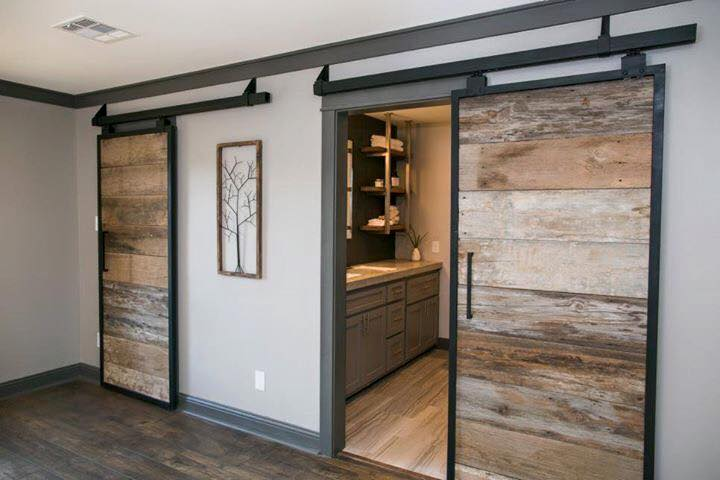 barn door leading to a bathroom
