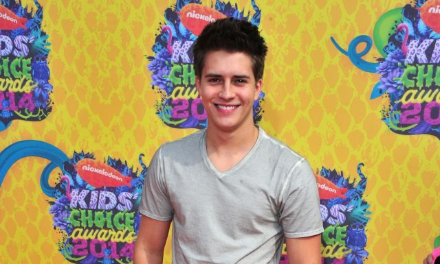 Billy Unger smiles on the red carpet for the Kids' Choice Awards.