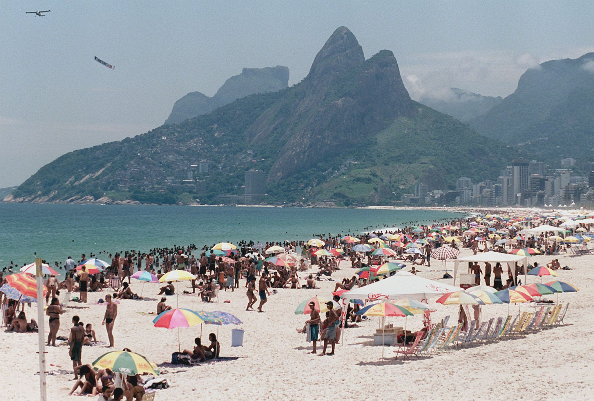 Beachgoers at Rio de Janeiro's Ipanema Beach take