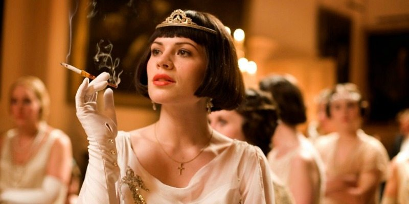 Hayley Atwell is in a dress and crown.