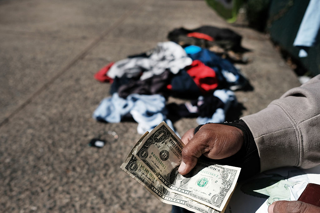 A man sells clothes on the street