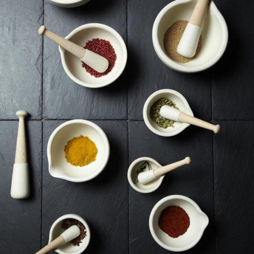 seveal mortars and pestles with spices
