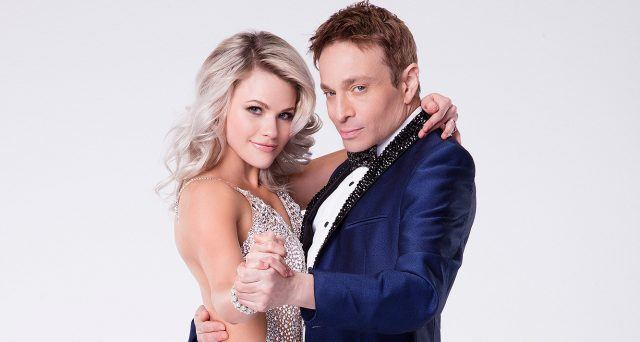Witney Carson and Chris Kattan pose as if they're dancing.