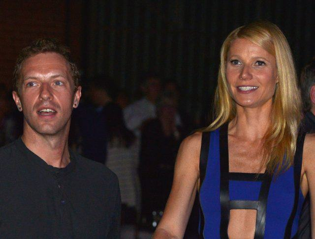 Coldplay's Chris Martin and actress Gwyneth Paltrow stand together and smile during a charity event.