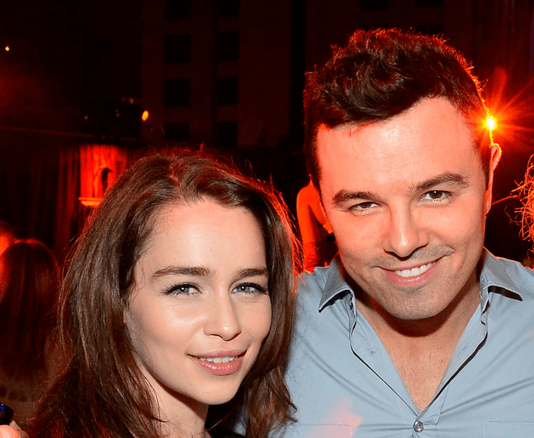 Emilia Clarke and Seth MacFarlane pose next to each other