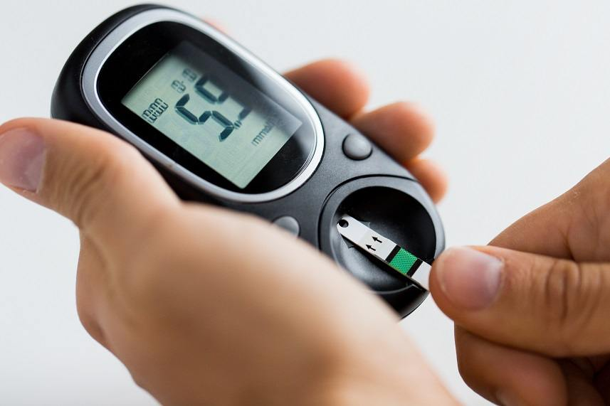 Man checking blood sugar level
