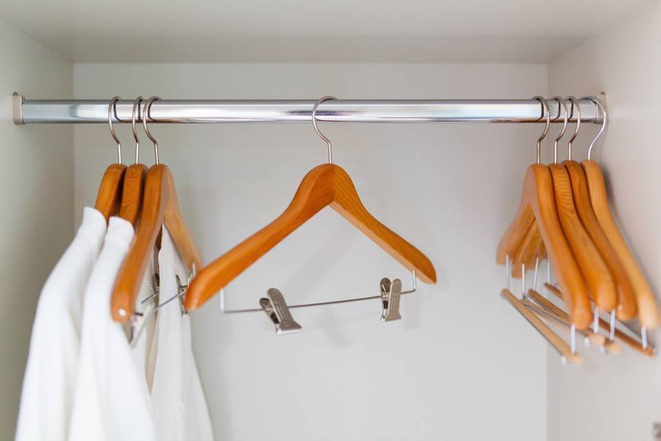 clothes hangers and white shower gown in clothes chest