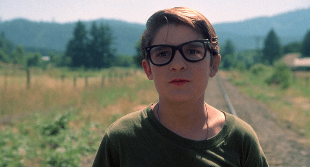 Corey Feldman looks concerned in a scene from 'Stand by Me.'
