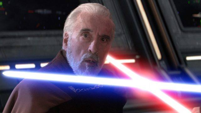 Count Dooku, with a blue and red lightsaber each pointed across his neck