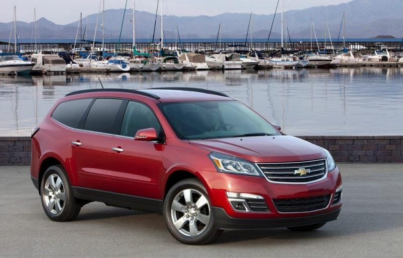 Front three quarter view of red Chevrolet Traverse