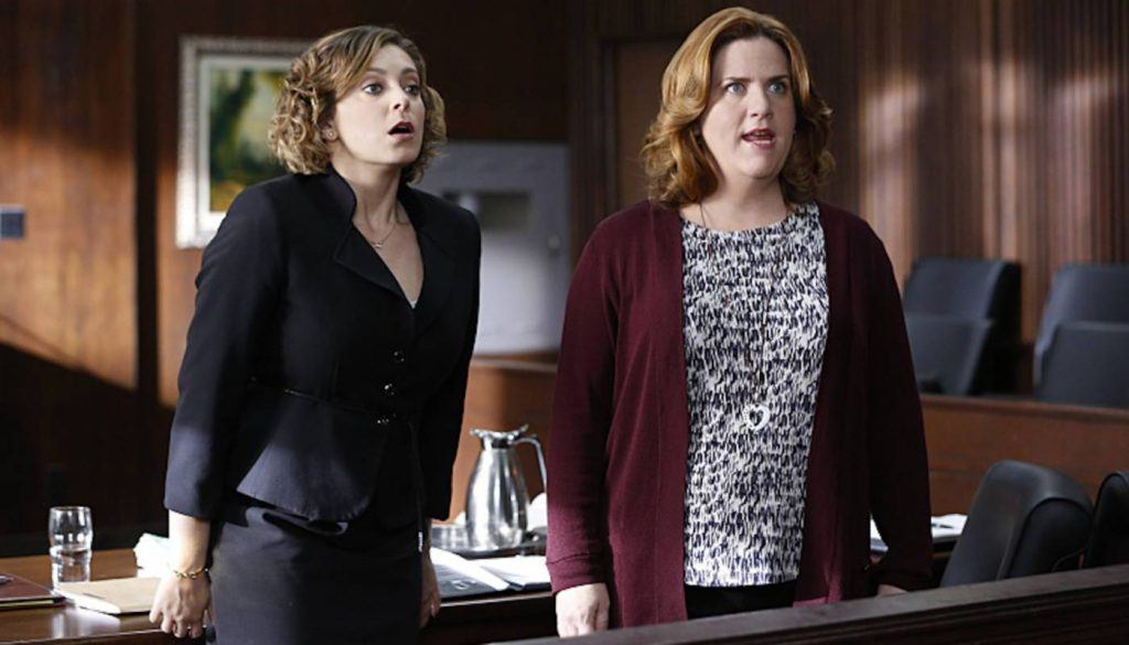 Rebecca and Paula in a courtroom