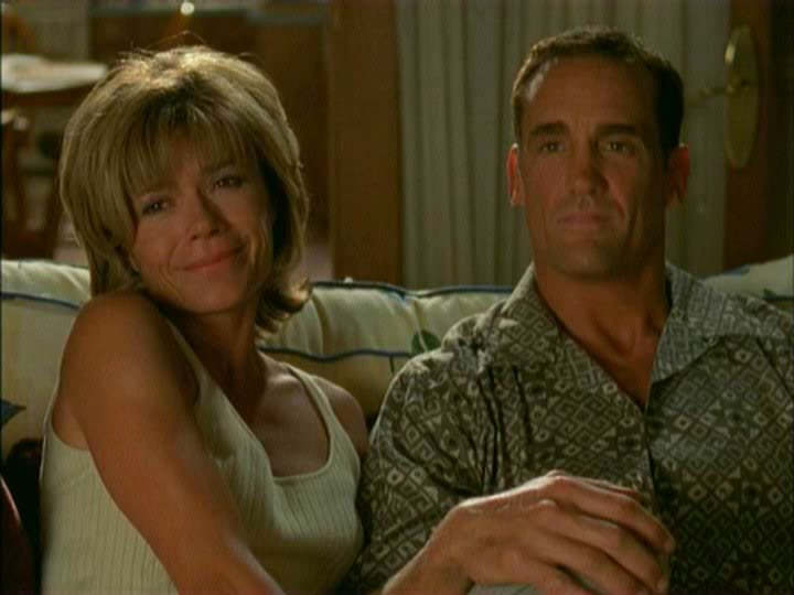 Gail and Mitch Leery sitting together on a couch