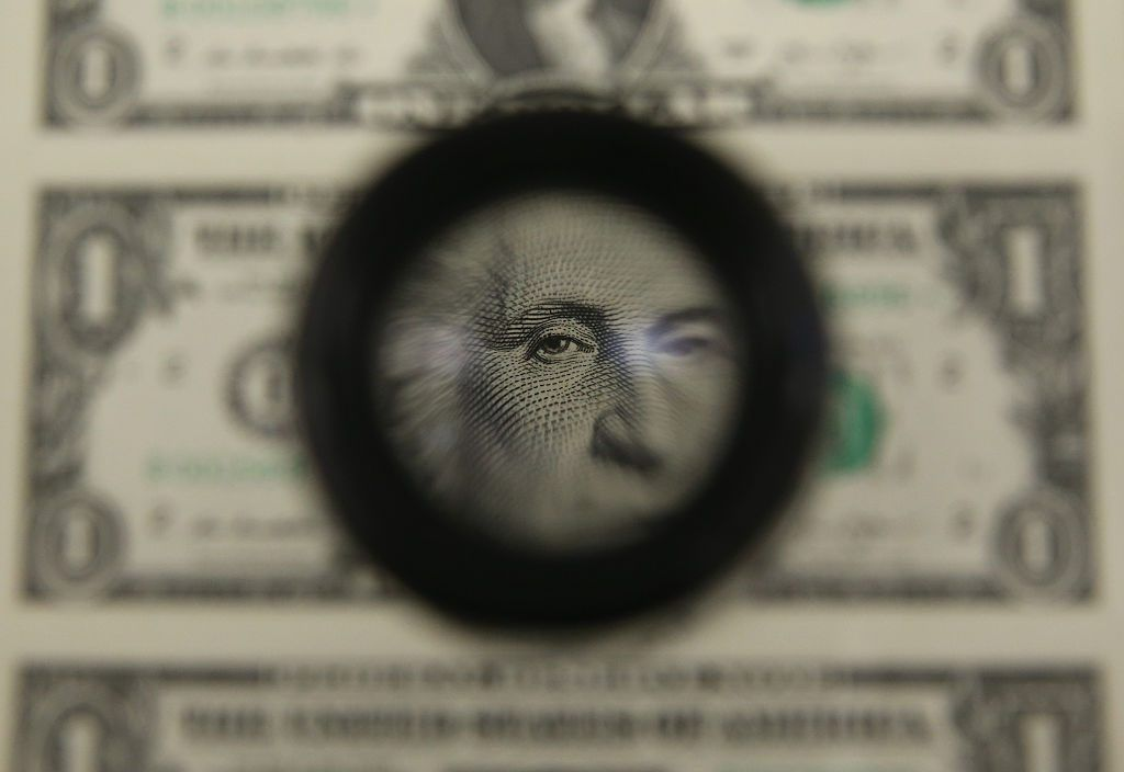 magnifying glass on dollar bill