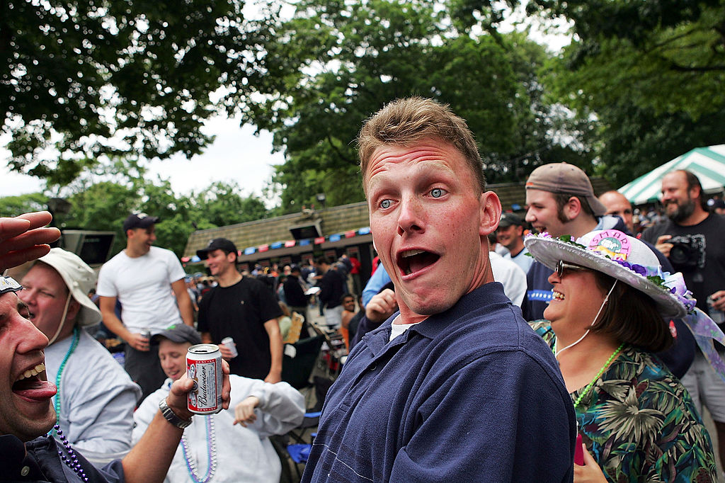 fan making face with beer