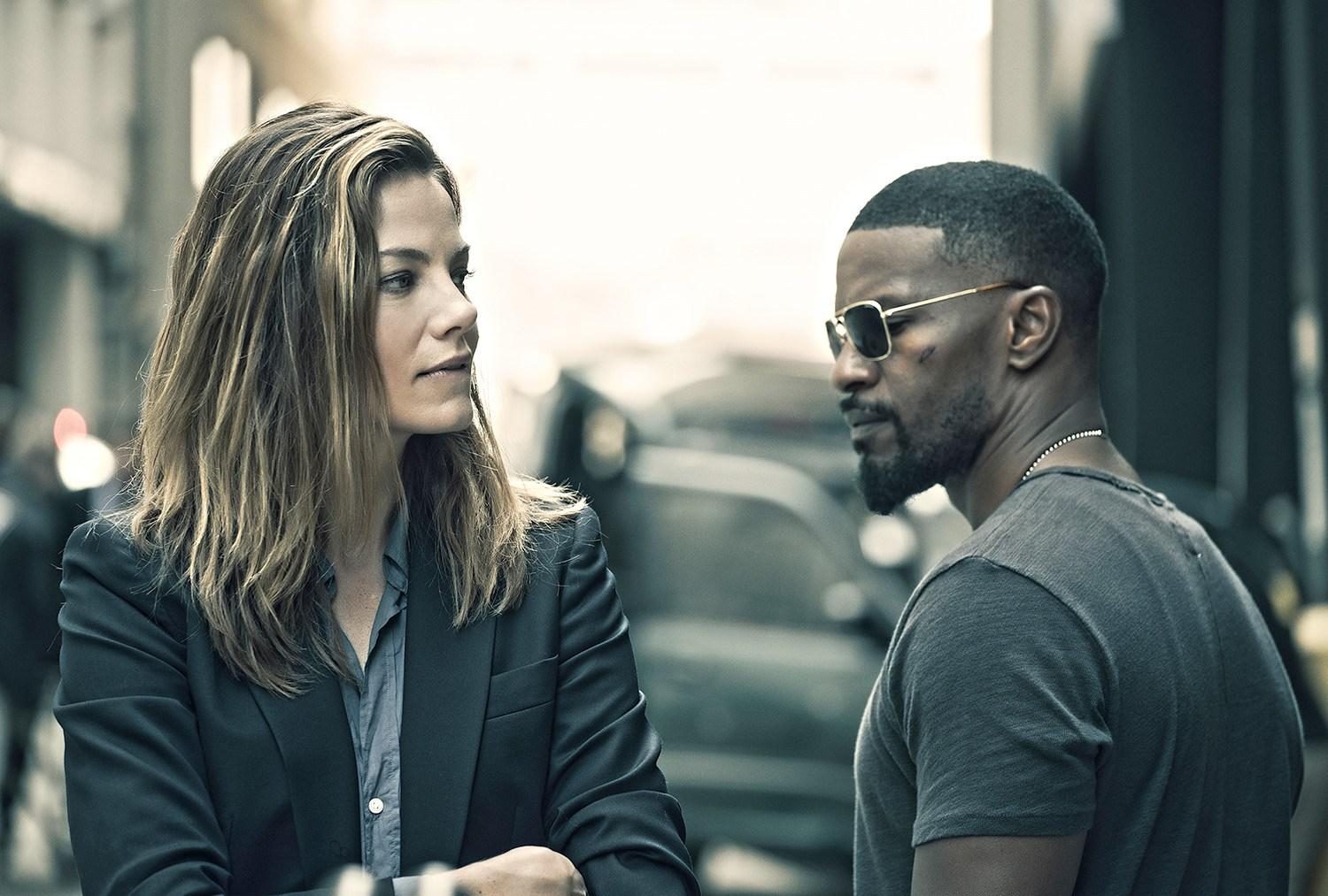 Michelle Monaghan and Jamie Fox stand next to each other in a street