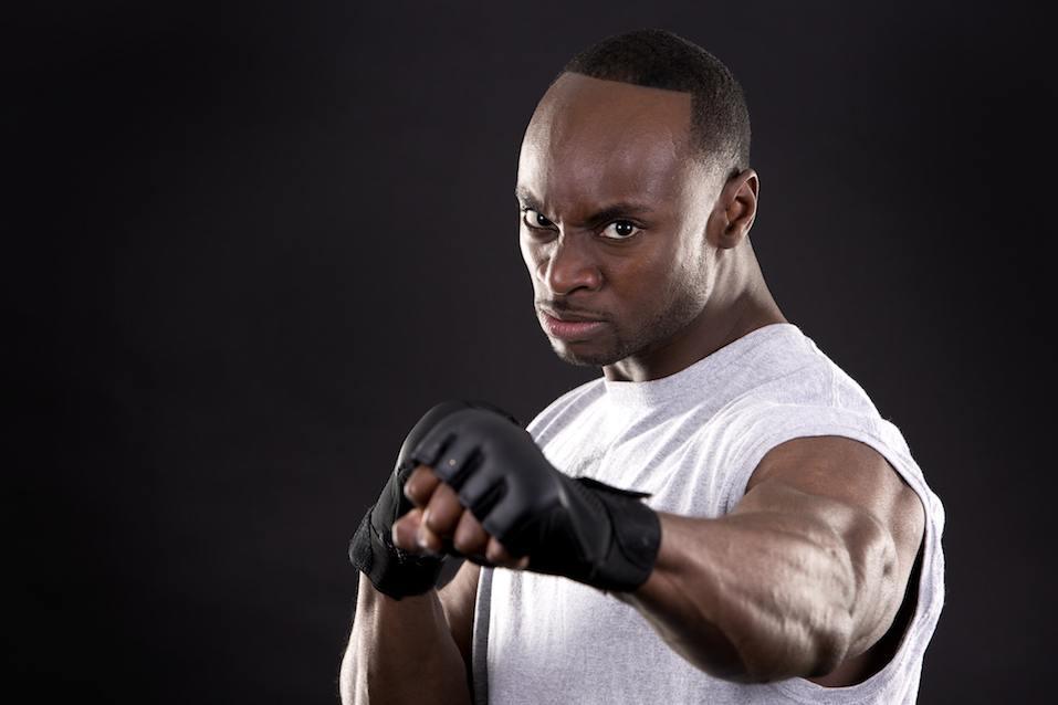 fitness man on dark background