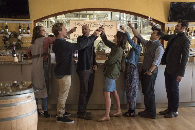 A group of friends raise their glasses in a toast