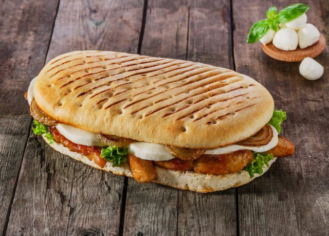 A panini is usually made with Italian bread and toasted.