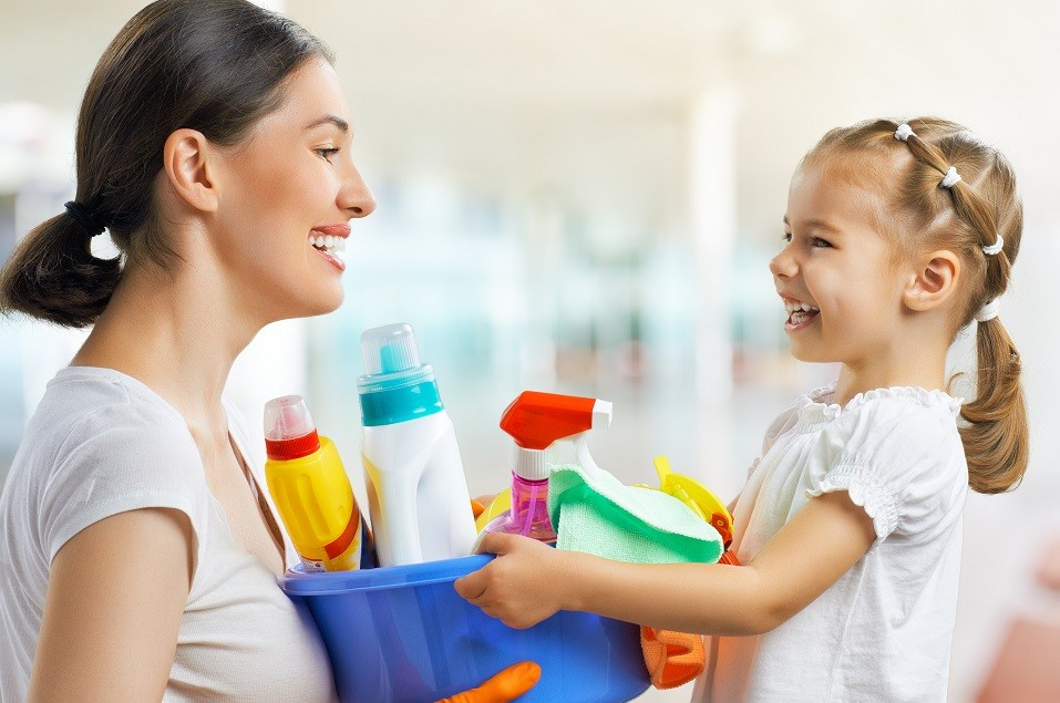 mother and daughter with cleaning supplies