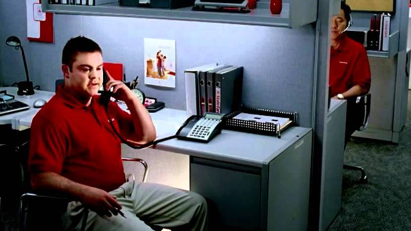 A khaki-clad Jake, from State Farm, on the phone discussing auto insurance