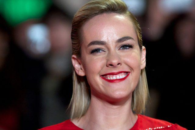 Jena Malone smiles on the red carpet for the premiere of 'The Hunger Games - Catching Fire.'