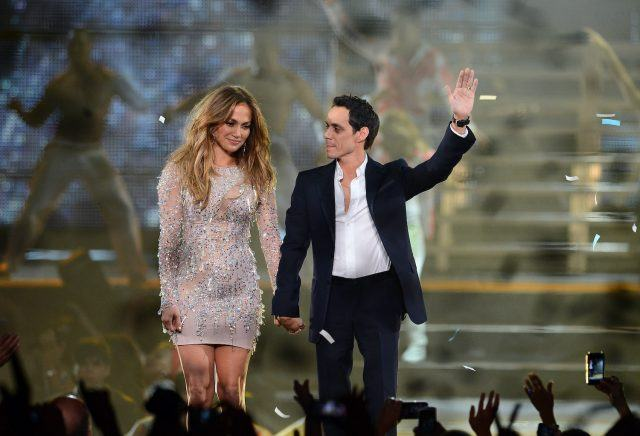 Former spouses Jennifer Lopez and Marc Anthony hold hands on stage at the Q'Viva: The Chosen Live concert in Las Vegas in 2012.