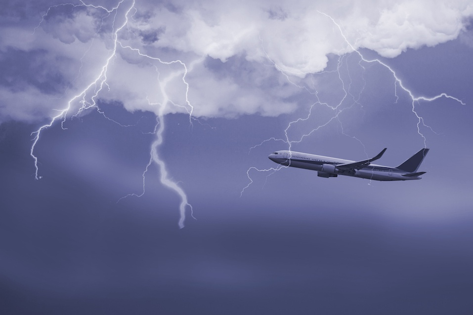 jet travelling through stormy sky