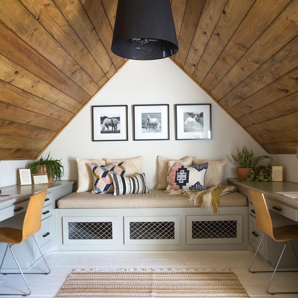 two desks in an attic room