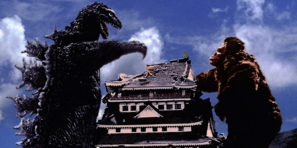 Godzilla preparing to fight King Kong, with each standing on either side of a large pagoda