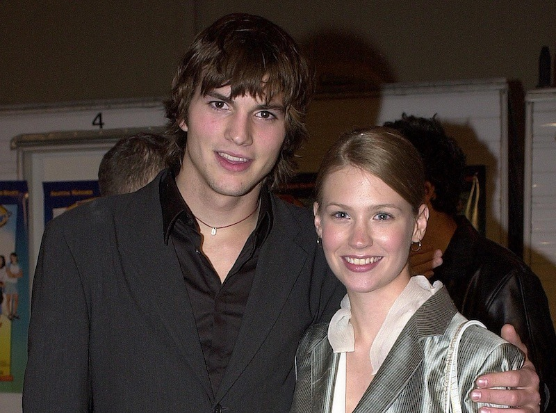 Ashton Kutcher puts his arm around January Jones