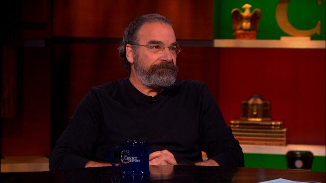 Mandy Patinkin, looking unamused, during an interview on 'The Colbert Report.'