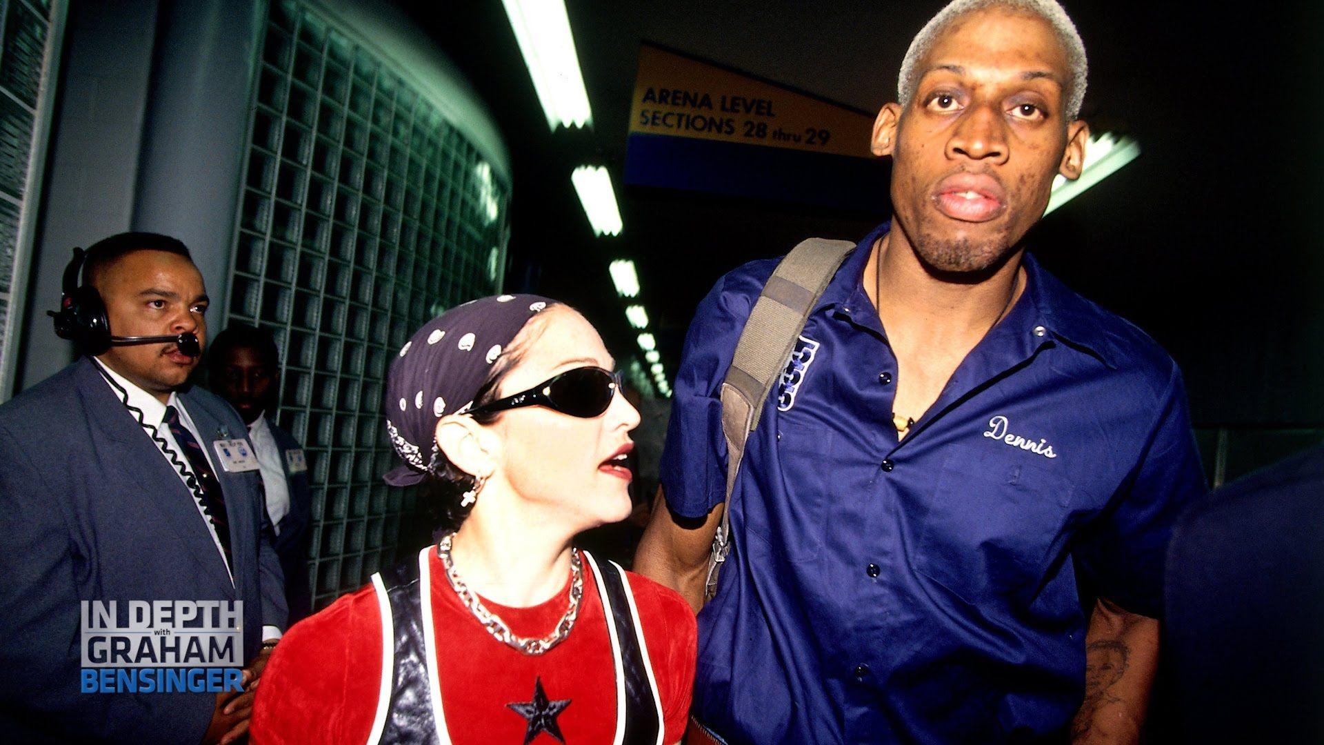 Madonna and Dennis Rodman walk together