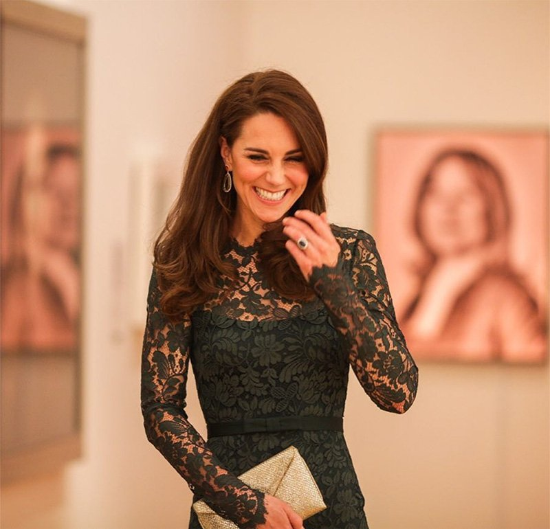 Kate Middleton smiles as she walks at an event