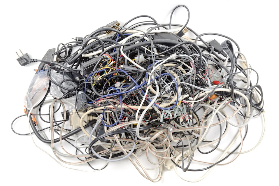 Interwoven tangle of wires on a white background