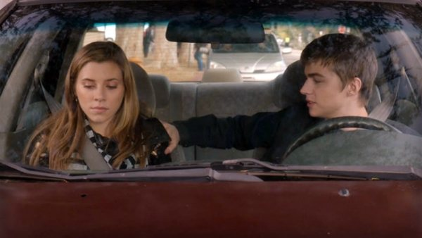 Amy and Miles sitting in a car