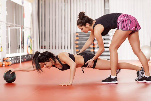 person exercises with an instructor.