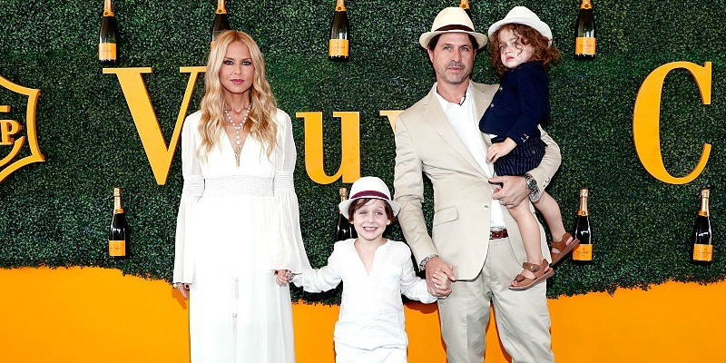 Rachel Zoe, Skyler Morrison Berman, Rodger Berman and Kaius Jagger Berman hold hands on the red carpet.