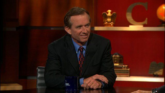 Robert F. Kennedy Jr. sitting at a table during an interview on 'The Colbert Report.'