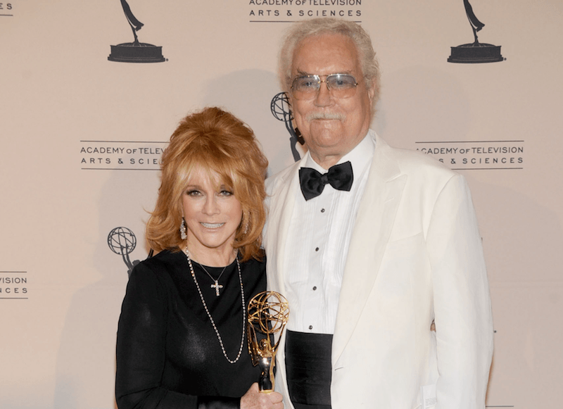 Roger Smith and wife Ann-Margret pose for cameras