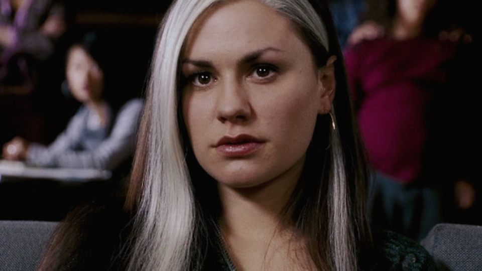 Anna Paquin as Rogue looking on