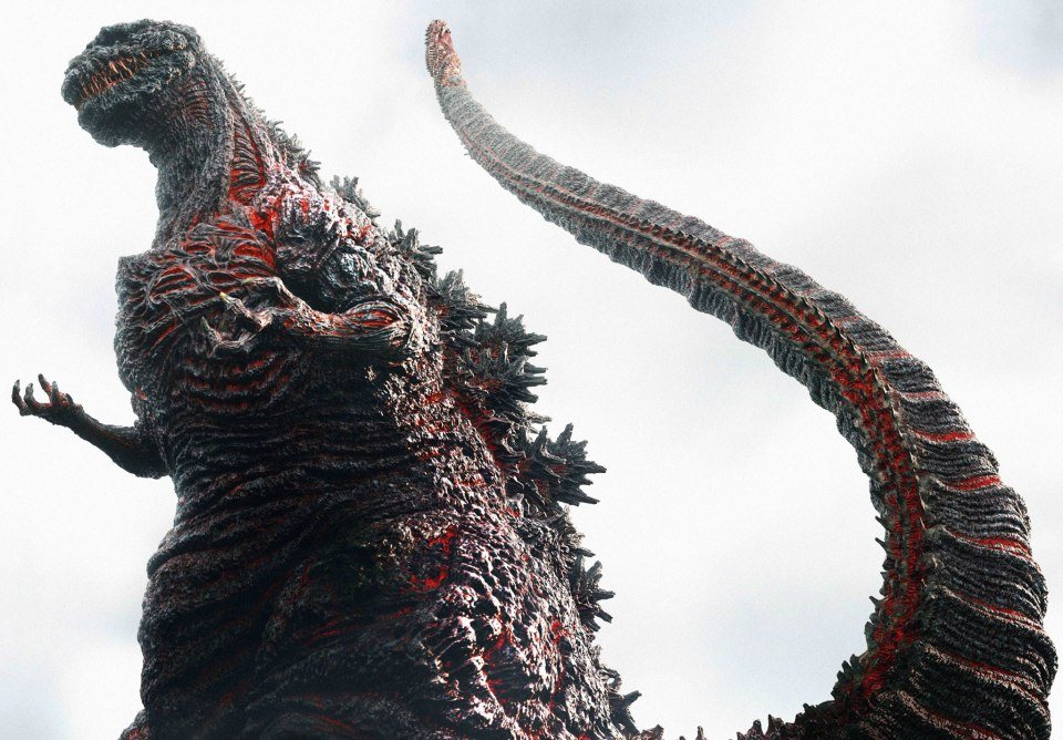 Godzilla, with red, heated parts of his scaled skin strewn across his body