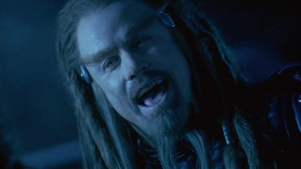 John Travolta as Terl, with long dreadlocks and a goatee, laughing into the camera