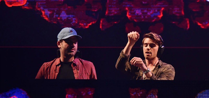 The Chainsmokers are behind the DJ booth together.