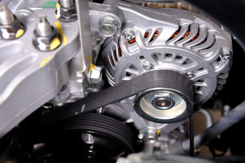 closeup car timing belt in clean engine room