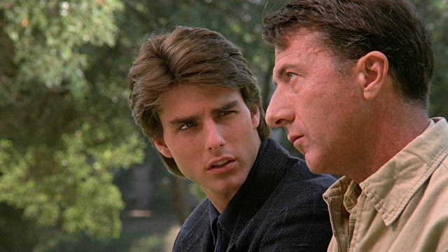 Tom Cruise talking to Dustin Hoffman, as Hoffman stares deadpan off into the distance.