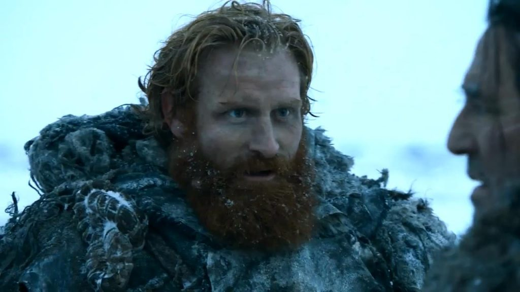 Tormund Giantsbane, standing in the snow and talking to a man off-camera on Game of Thrones