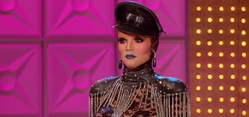 Willam is dressed in a bodysuit and hat.