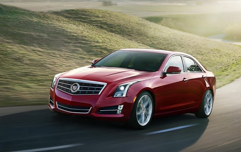 Front three quarter view of red Cadillac ATS, 2014 model year, from driver side